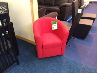image of a red armchair in a showroom
